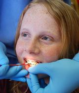 Micanopy 7th grader Elizabeth Tallon gets a fluoride varnish application.