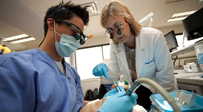 D.M.D. student and faculty member Dr. Nery Clark in the dental simulation lab