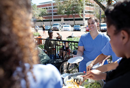 Magda AbdelFattah and classmates provide a free lunch for homeless people in Gainesville