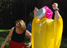 ...and hits her target: Dr. David Stillwell, who was a great sport for a great cause.