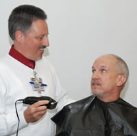 Dr. Marc Ottenga prepares to do the shaving honors.