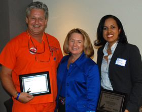 From left: Dr. Larry Grayhills, Dean Dolan and Dr. Yvette Godet.
