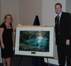Dean Teresa A. Dolan and Class President Phil Hedger with the class gift to the college in memory of Frank Collins, D.D.S.