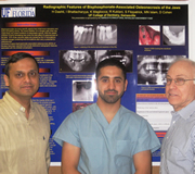 From left: Dr. Indraneel Bhattacharyya, Dr. Hussain Dashti, and Dr. Don Cohen pose with Dr. Dashti's winning poster.