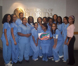 Members of the UF SNDA Chapter pose with their award-winning scrapbook.