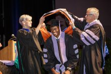 Stephen Obeng, D.M.D., M.S., is hooded during the 41st UF College of Dentistry Commencement at the Curtis M. Phillips Center for the Performing Arts on May 20, 2016.